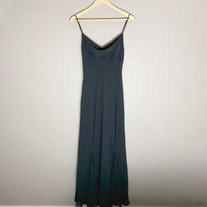 Vintage black evening dress with draped neckline.